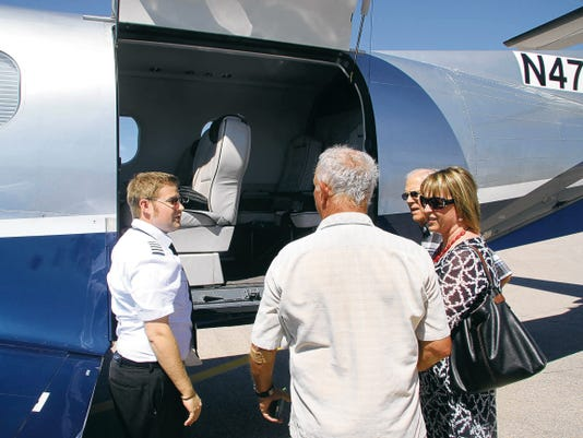 KATIE ENGLAND -- CURRENT ARGUS   After the first flight from Dallas landed at the Cavern City Air Terminal, those attending the event were given the opportunity to view and enter the inside of the Boutique Air planes.