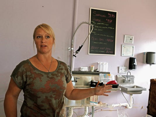 Owner Michelle Shahan talks Thursday about the simple menu at Aztec's Sweet Pea Cafe.