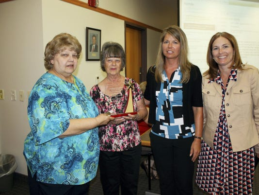 Judy Cook, second from left, was recognized by Chambersburg Area school board on June 17 for her retirement after 42 years as a bus driver. Pictured to her left is LaDonna Naugle, transportation supervisor. On her right are Bobbie Stine, assistant transportation supervisor, and Tammy Stouffer, director of support services. Submitted photo.