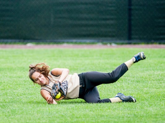 Delone Catholic left fielder Marlee Lackey makes a diving catch against Philadelphia Academy Charter School during the Squirettes' 6-0 win Wednesday in the PIAA Class AA first round.