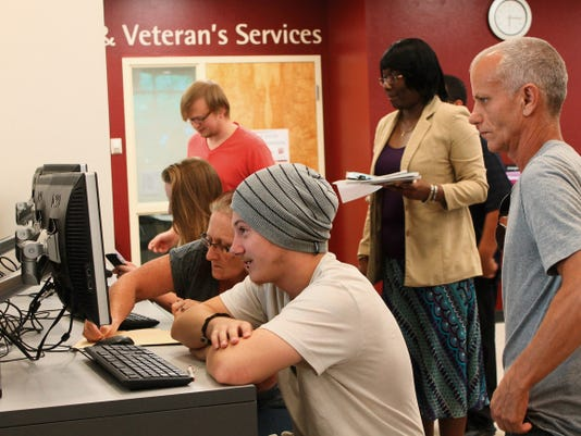 NMSU-A Deputy Chief of Student Affairs Dr. Vandeen McKenzie watches over potential students as they fill out admissions applications and financial aid forms.