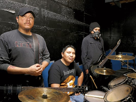 Daily Times file photo Chuck Haven, left, Brandon Tsosie and Brandon Curley pose photo on Feb. 28 during Signal 99 rehearsal at Studio 18 in Farmington.