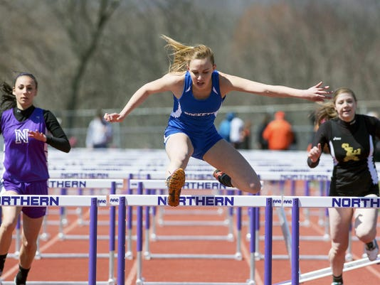 Zoe Stauffer of Spring Grove defeated Ashley Marconi, left, of Northern and Lily Singleton of Delone Catholic in the girls' 100-meter hurdles at the Arctic Blast Invitational on April 11.