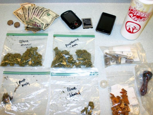 This 2011 photo shows drugs that police said they took from the backpack of a student allegedly trying to sell them at Dover Area High School.