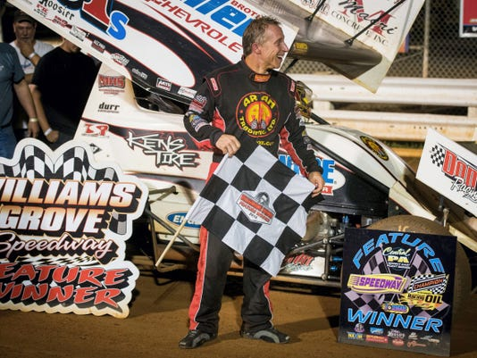 Stevie Smith celebrates with the checkered flag Friday after winning the 25-lap 410 sprints feature race on the opening night of Pennsylvania Speedweek at Williams Grove Speedway in Mechanicsburg.
