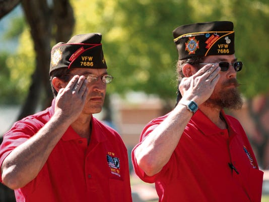 Richard Nutt and Warren Booker of the Veterans of Foreign Wars, Post 7686, saluted the flag during a memorial service at the Immaculate Conception Catholic Cemetery Monday morning. The VFW also held a service at the Monte Vista Cemetery to remember and honor veterans who have died.