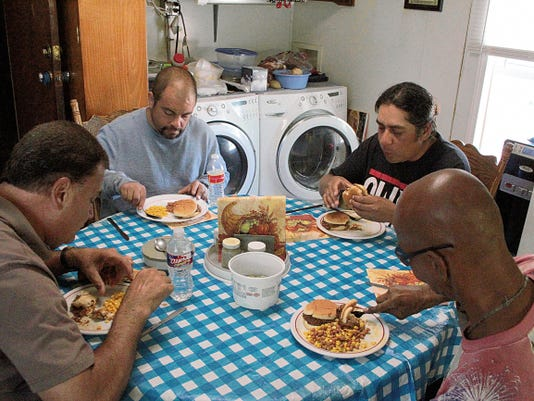 Four men enjoyed a free lunch of brisket sandwiches with corn and baked beans at the House of Prayer's day shelter for the homeless. Located at 601 Delaware Avenue, the House of Prayer also serves breakfast and provides Alamogordo's homeless with a place to shower and do laundry free of charge.