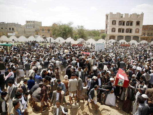 Shiite rebels known as Houthis bury fellow Houthis, who were killed in a suicide bomb attack, during their funeral Friday in Sanaa, Yemen.