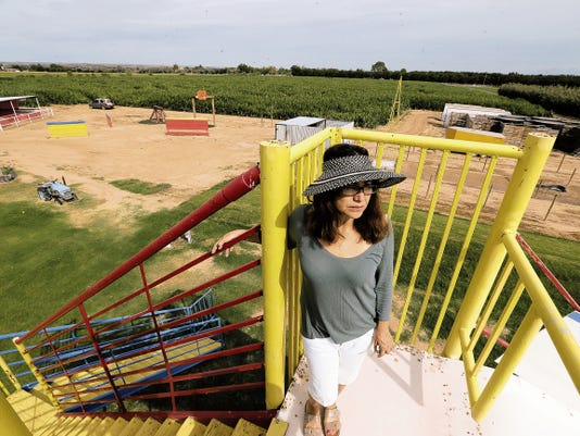 Lucy Sondgeroth owner of La Union Maze & Pumpkin Patch stands at the top of the slide that has become a crowd favorite.