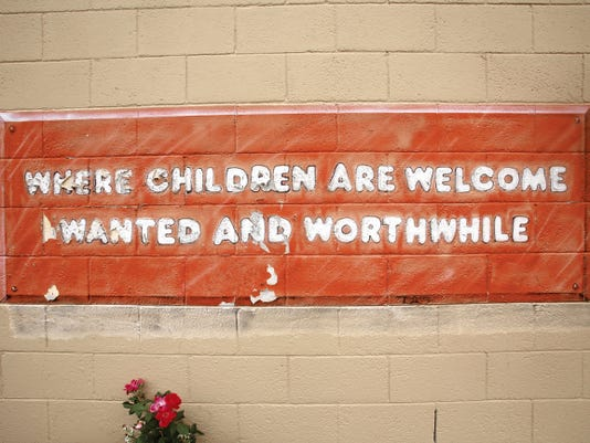 A sign painted on an outside wall as seen Wednesday at McCormick Elementary School in Farmington.