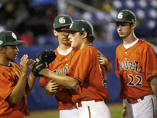 Prairie Gravel pitcher Quinn Snarkskis is greeted by his teammates on Friday during Game 22 of the Connie Mack World Series at Ricketts Park in Farmington.