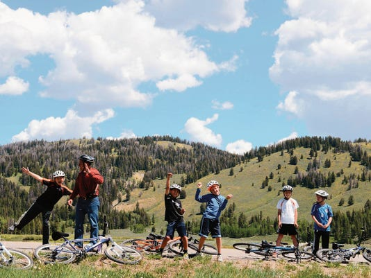 For years known as Elderhostel, Road Scholar provides travel experiences for young people, too, as this Wyoming scene testifies.(Courtesy Carl Studna/Road Scholar)