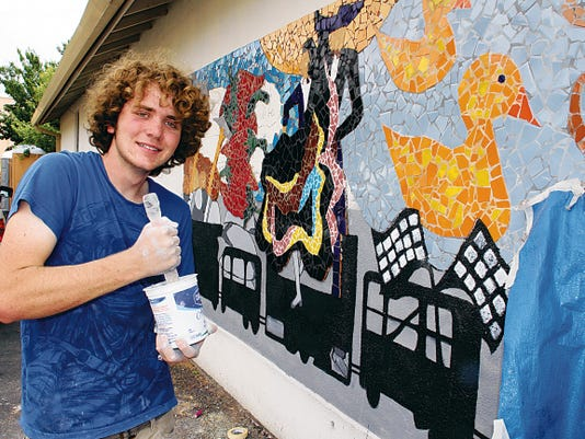 Bill Armendariz — Headlight Photo   Wyatt Potorff, 18, a May graduate of Deming High School, worked on the Luna County mural next to the Road Department, behind the historic Luna County Courthouse. Potorff says he enjoys doing the larger and surreal projects and has kept busy after graduation by selling T-shirts he designs with his artwork.