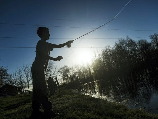 Jesse Shaffer, 12, casts his fly fishing rod into the pond at Granite Hill Camping Resort on Saturday morning April 18 during the trout fishing derby. Anglers of all ages were dipping their fishing poles in the water in a chance to catch prize winning trout on Saturday.