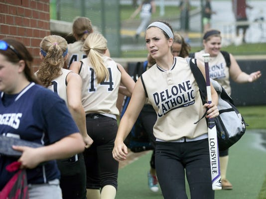 Delone Catholic's Shelbee Holcomb and the Squirettes gather their gear Monday after their PIAA Class AA softball tournament first-round game against Philadelphia Academy Charter was suspended by rain. The game is scheduled to resume at 4:30 p.m. Tuesday at York College, with Delone holding a 4-0 lead at the top of the second inning.