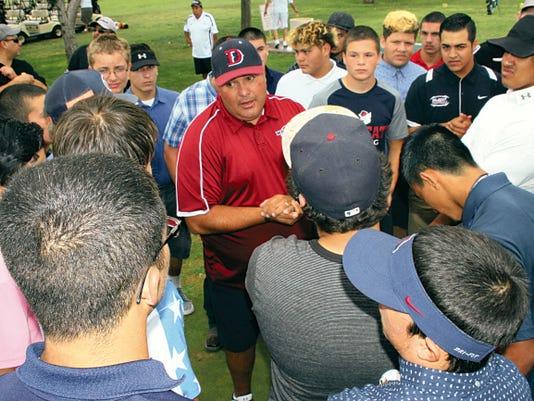 Bill Armendariz - Headlight Photo   Deming High Football Coach Fernie Holguin talks to his varsity players during the recent Wildcat Golf Scramble to raise money for the program.