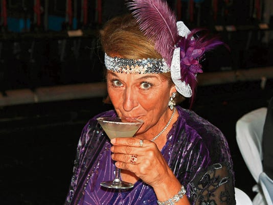 Patricia Schroeder samples a Speakeasy Martini at last year's annual event.