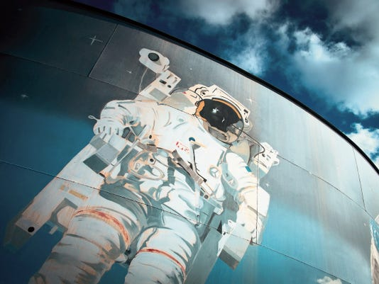 An astronaut appears to float in space in a mural highlighting moments of space exploration at Space Murals Inc., Museum in Organ, just outside of Las Cruces.