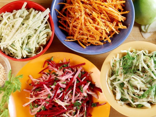 Clockwise form top left: Kohlrabi slaw with creamy avocado, carrot slaw with miso vinaigrette, shaved fennel with arugula crunch salad and raw beet salad with fennel.