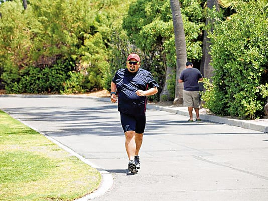 Robert Lara, an attorney in the 3rd Judicial District Court in Las Cruces, trains for the 2015 Nautica Malibu Triathlon taking place in Malibu, Calif. on Sunday. It will be Lara's first triathlon.