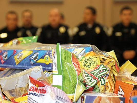 Bill Armendariz - Headlight Photo   Plastic tubs filled with candy and snack treats were distributed to local law enforcement and safety workers during Friday's Heroes' Appreciation Day at Memorial Elementary School.