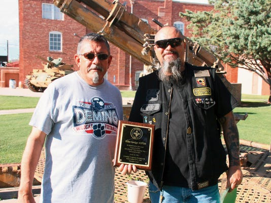 Bill Armendariz — Headlight Photo   Deming Elks 2750 Exalted Ruler George Torres, left, received a plaque from Combat Veterans Motorcycle Association President William Fisk, of the Las Cruces Chapter, in appreciation of the work the Elks organization does for veterans organizations nationwide. The Deming Elks recently donated 1,000 to the Las Cruces CVMA whose members come from Dona Ana and Luna counties.