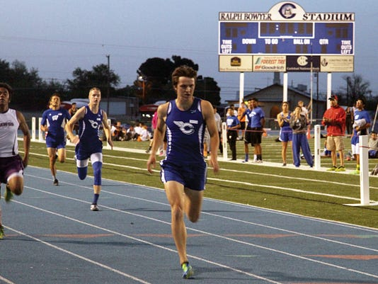 PHOTO BY AARON BRACAMONTES/ Current-Argus   Carlsbad senior Kevin Johnson outlasts Midland sophomore Nick Garcia and fellow Cavemen senior Tyler Eaton to win the 400-meter dash in a time of 50.47 seconds Friday night at the Ron Singleton Invitational at Carlsbad High School.