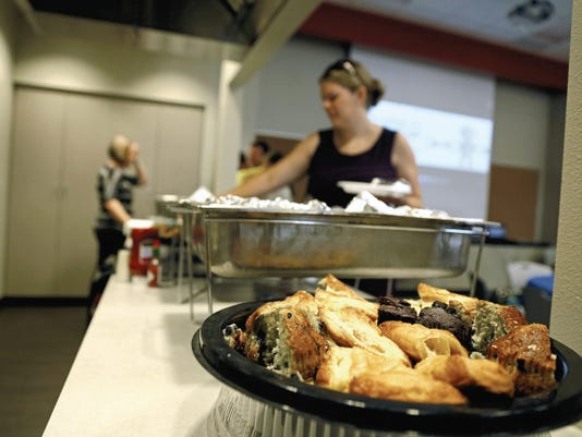 Participants get breakfast before listening to speakers Thursday during the San Juan United Way Pacesetter breakfast at the Presbyterian Medical Services Community Health Center in Farmington.