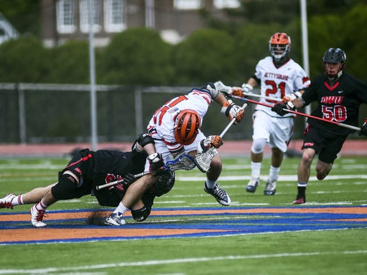 Ohio Wesleyan's Trent Schulte and Gettysburg's Geoff Fulgione fight for the ball during Wednesday's NCAA Division III men's lacrosse quarterfinal at Gettysburg. The Bullets won, 9-5.