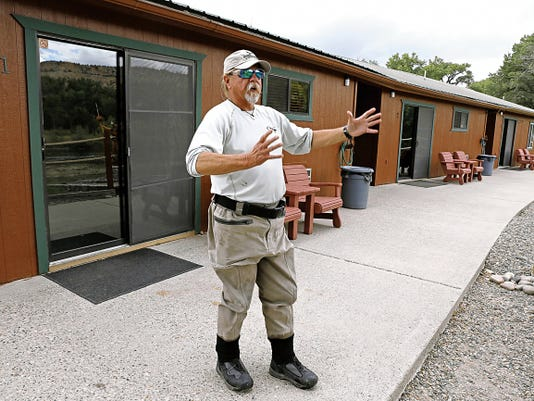 Larry Johnson, owner of Soaring Eagle Lodge, talks about the atmosphere at his lodge during an interview on Friday.