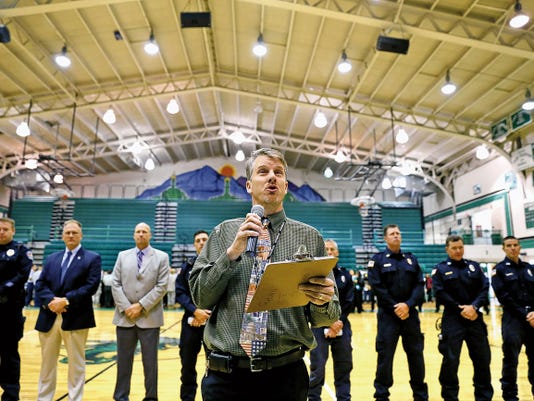 Principal Tim Kienitz speaks Friday during a pep rally in the Scorpion Gym at Farmington High School.