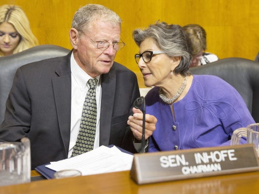 Senate Environment and Public Works Committee Chairman Sen. Jim Inhofe, R-Okla., left, talks with the committee's ranking member Sen. Barbara Boxer, D-Calif., on Capitol Hill in Washington on Wednesday before the start of the committee's hearing with Environmental Protection Agency Administrator Gina McCarthy on the Gold King Mine wastewater spill.