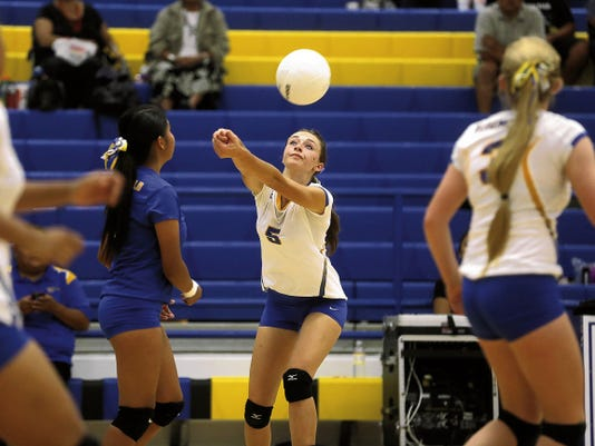 Bloomfield's Maddy Waresback hits the ball Saturday during a match against Crownpoint at Bobcat Gym in Bloomfield.