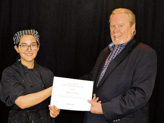 Courtesy   President of the Jockey Club, Richard Zelt congratulates Noelle Francis on her scholarship.