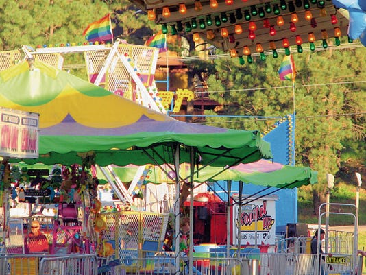 The glitter of a visiting carnival lured people to the rides all weekend.
