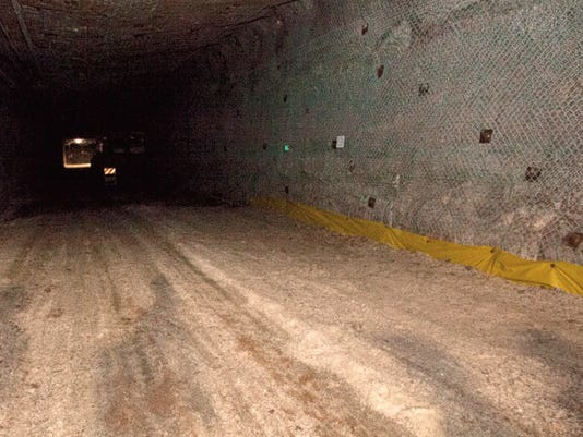Photo Courtesy of the Department of Energy.   Brattice cloth can be seen laid on the floor of the mine and covered with mined salt.