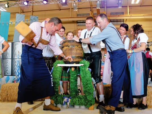 Commander of the GAFFTC Col. Armin Havenith and Holloman's 49th Wing Col. Robert Kiebler tapped the Oktoberfest beer keg opening the celebration.