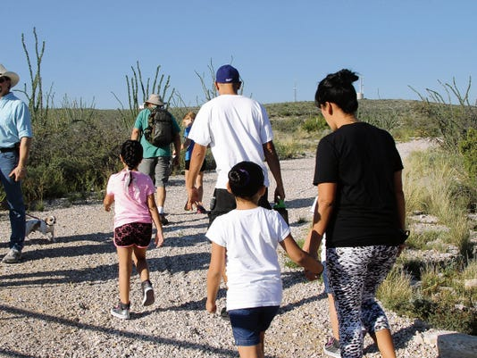 SARAH MATOTT - CURRENT-ARGUS   Families came out on Saturday morning to march the Ocotillo Trail up to the Living Desert Zoo and Gardens Park for March for Parks, an event created to help raise money that goes to the area's local parks.