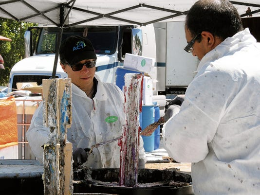 JESSICA ONSUREZ   Memebers of ACT Environmental Services collected paint in barrels for disposal as part of the hazardous waste disposal event hosted by Keep Carlsbad Beautiful Saturday at the Carlsbad beach.