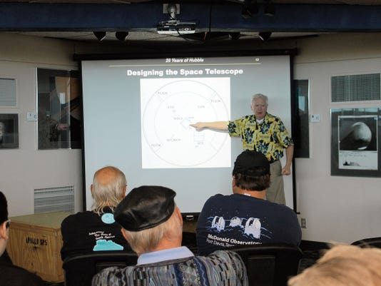 Museum Education Director Dave Dooling discusses the design of the Hubble space telescope and what its purpose is at the New Mexico Museum of Space History Friday morning.