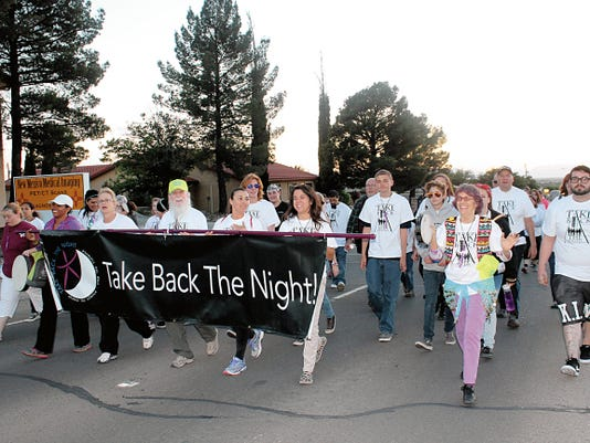 """Attendees of Take Back The Night Alamogordo marched along Scenic Drive and Indian Wells Road with police escourts to take a stand against sexual assault and domestic violence in the community. """"It's important to raise awareness and to help the community at large understand what it is and that it happens to both genders, all ethnicity, all socioeconomic groups, there are no boundaries to sexual assault or domestic abuse,"""" said event chair, Fran Johnston."""