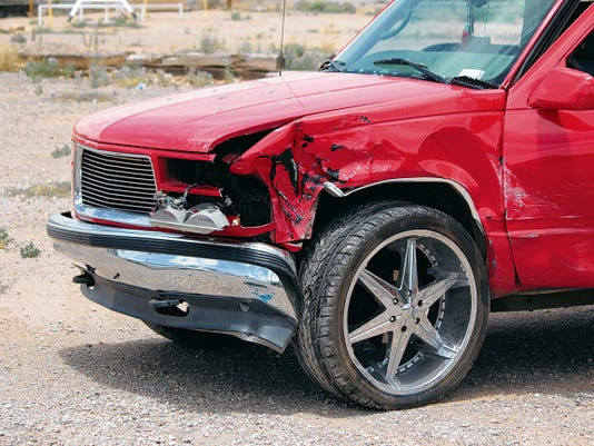 Damage to the front of a red 1997 GMC Suburban shows where the vehicle struck a blue 2014 Ford Sedan at White Sands Boulevard and Indian Wells Avenue. Alamogordo Police Department Lt. Tracy Corbett said officers and American Medical Response were dispatched to the accident at 1:30 p.m. Friday The department may ticket some of those involved pending a review of witness statements and the crash report.