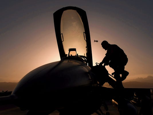 Senior Airman Joseph Santana, a 455th Expeditionary Aircraft Maintenance Squadron crew chief, completes an F-16 Fighting Falcon post-flight inspection at Bagram Airfield, Afghanistan, June 8. The 455th EAMXS ensure Fighting Falcons on Bagram are prepared for flight and return them to a mission-ready state once they land.