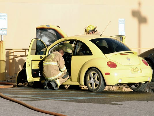 Firefighters responded to a fire in the hood area of an unoccupied 2009 Volkswagon yellow Beetle parked in the handicapped parking space next to the hospital's ER entrance around 7 p.m.
