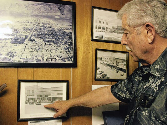Wadell Maupin points to old photographs of Alamogordo and his father's old stores. Maupin's Home Furniture, orginally owned by Wadell's mother and father, Edna May and Wade Maupin, has been in business in Alamogordo since 1945.