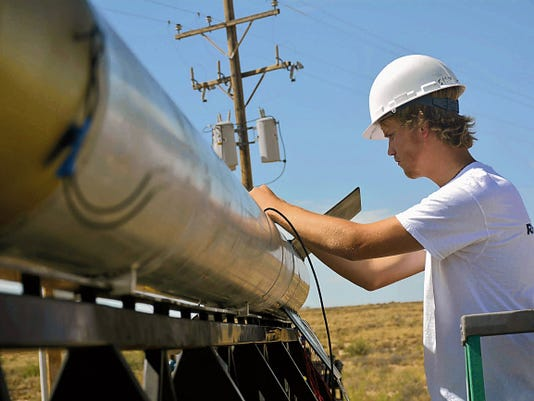 Connor White, a student from Marble Falls High School, does some last minute tweaks to the school's rocket, July 6 at White Sands Missile Range.