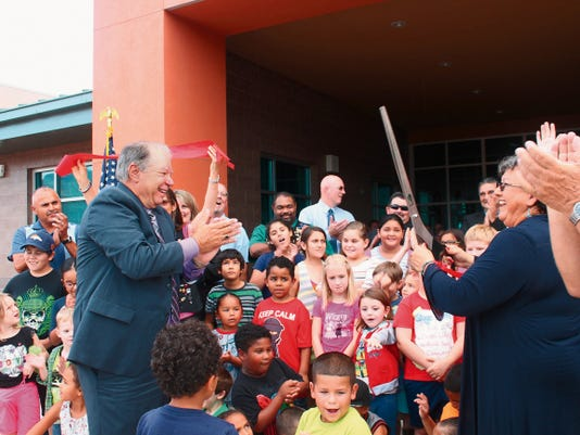 Former Alamogordo Public Schools Superintendent Dr. George Straface and current Superintendent Adrianne Salas celebrate cutting the ribbon together, which opened Desert Star Elementary to the community on Wednesday evening. Since its inception in 2003, both Straface and Salas have worked to open Desert Star Elementary within the district.