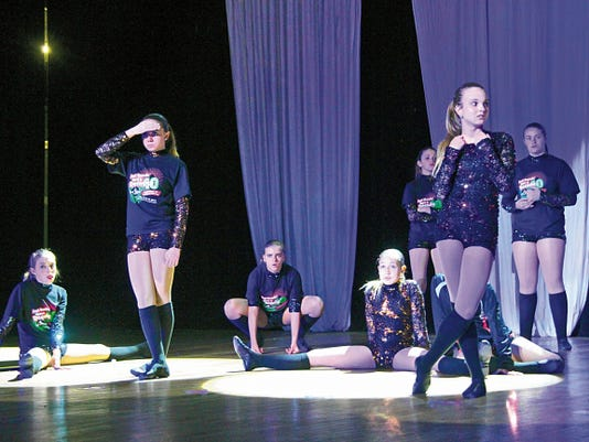 """Dancers from the Just Dance studio rehearse for their performance in """"Just Dancing Through the Decade."""" The performance is at 5:45 and 8 p.m. Friday and Saturday at the Walter Gerrells Arts and Exhibition Center."""