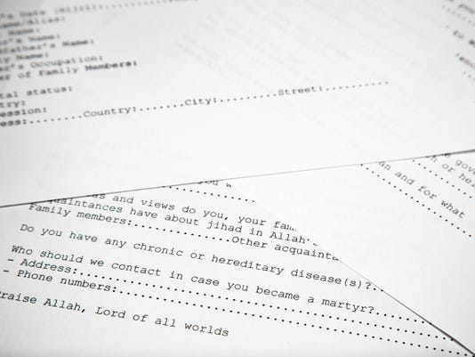 A translated copy of an application to join Osama bin Laden's terrorist network is photographed Wednesday in Washington.