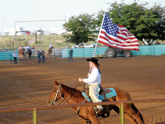 SARAH MATOTT - CURRENT-ARGUS   The Eddy County Posse Riders performed in the arena before the presentation of the colors and before the bull riding events began at the Smokin on the Pecos Rodeo on Friday night.